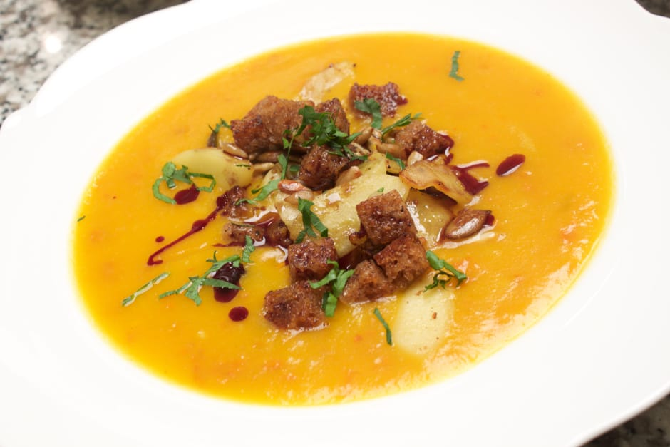 Pumpkin soup Recipe with seed oil in addition apple cubes and black bread croutons Picture and recipe of (c) Thomas Sixt