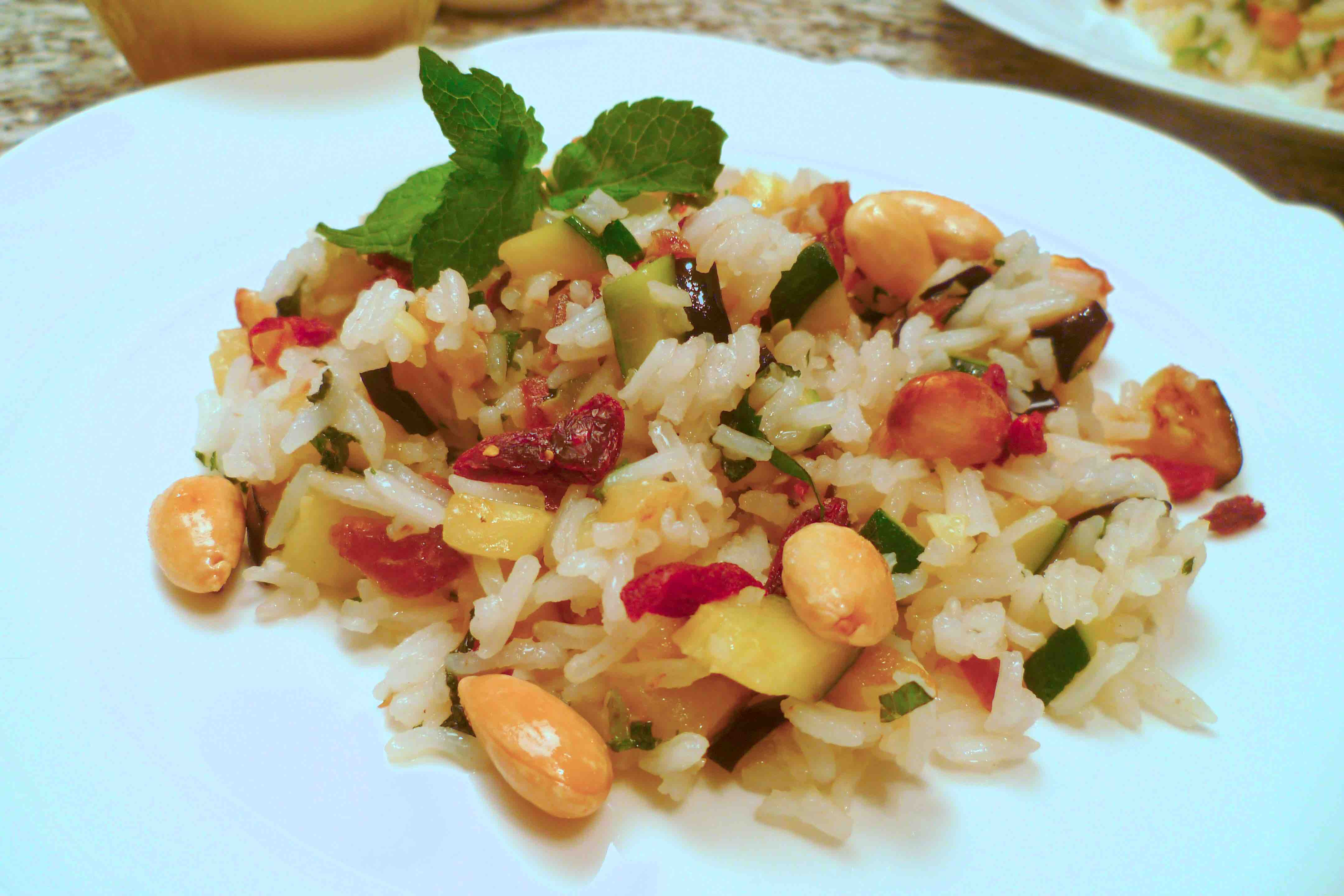 Healthy and Oriental: Rice Salad with Mint, served with Almonds, Dates and Vegetables