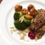 venison in pepper cream sauce with chestnuts and broccoli