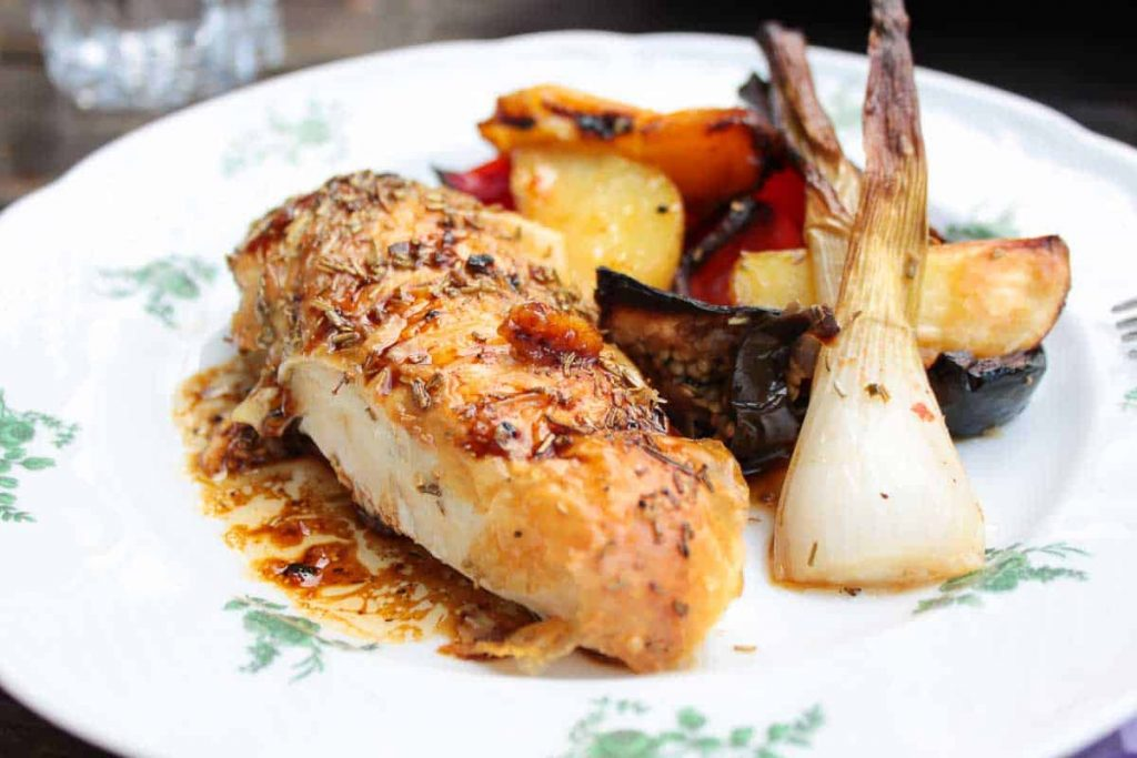 guinea fowl with herbs and vegetables as side dish