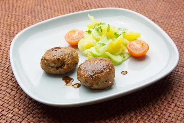 Meatballs with potato salad and cucumber