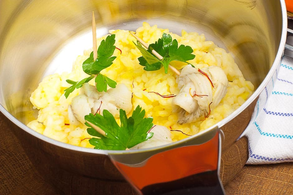 Saffron risotto tastes good with shrimps, prawns and fish.