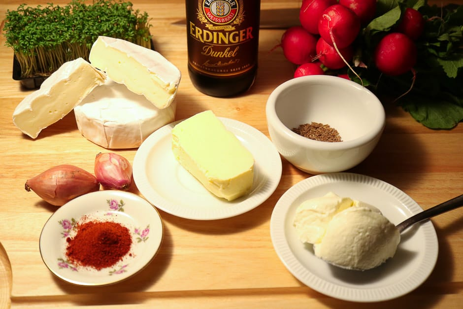 The ingredients for the obazden prepared on a board...