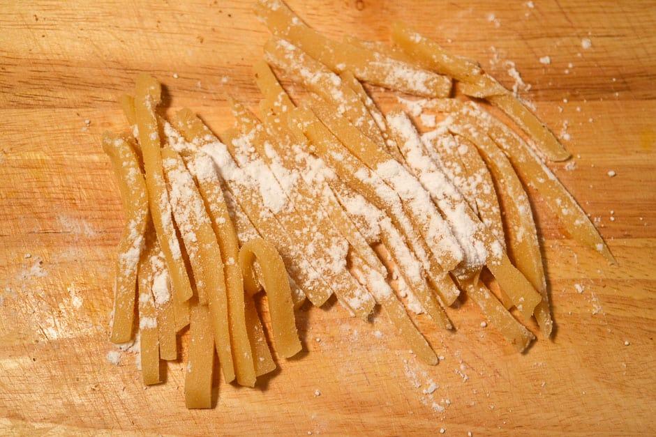 Cutting marzipan on the board.