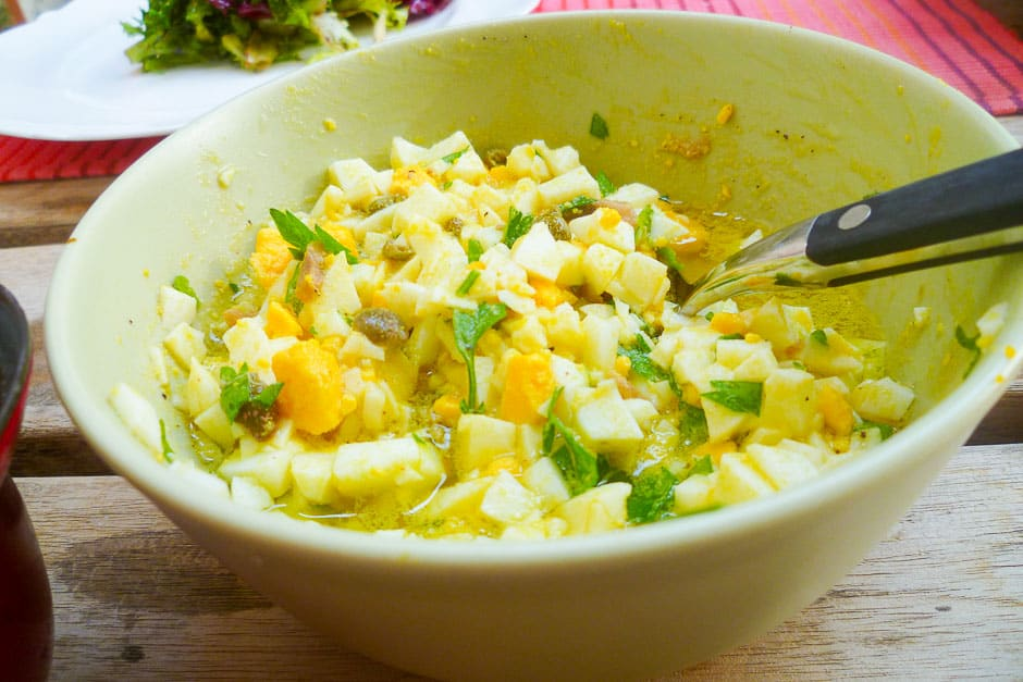 Egg sauce or cold dip with eggs, capers, parsley and olive oil.