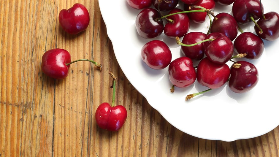 Fresh cherries on a plate.