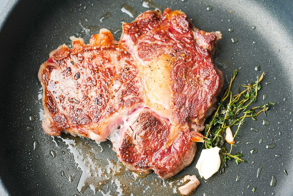 Turn the steak over while frying.