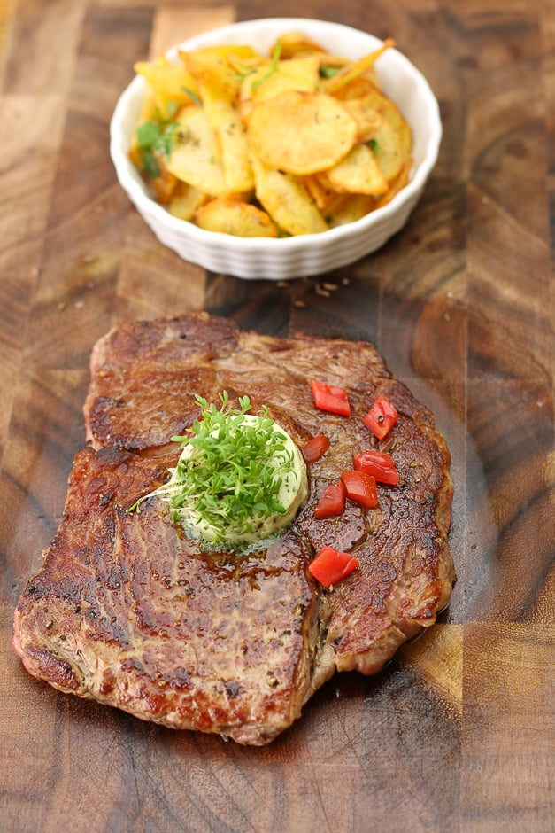 Steak with fried potatoes portrait format picture.