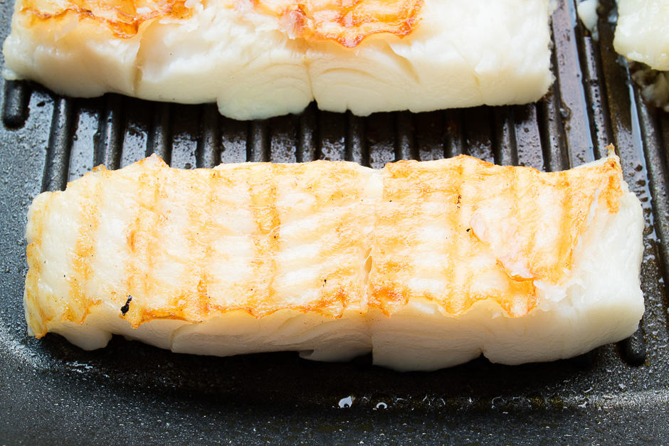 Halibut fillet fried in the pan.