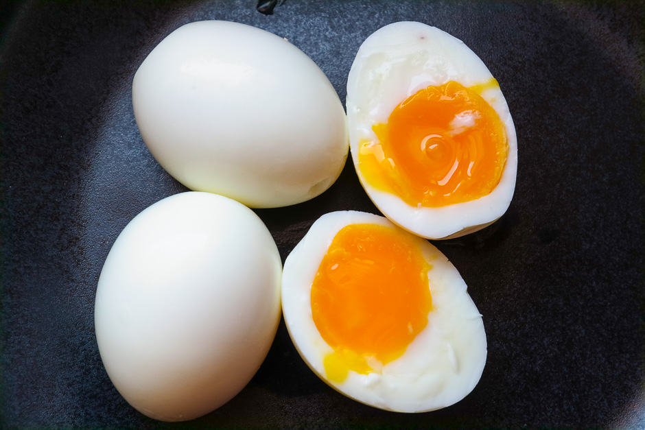 Peeled and soft boiled eggs